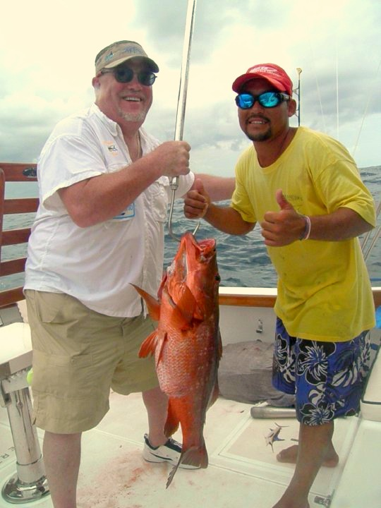 My Friend Robert  (he likes to see his picture) With First Mate Carlos and a nice Snapper!