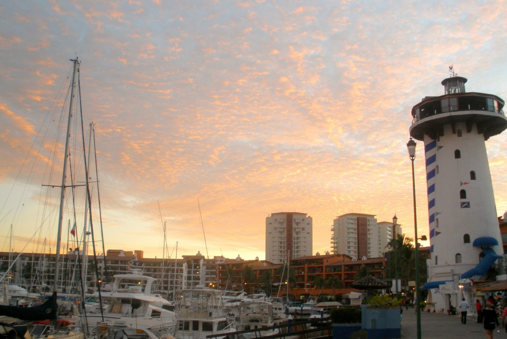 Sunset in Marina Vallarta with El Faro Light house bar featured