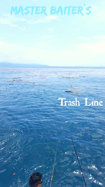 Trash Line, it can be debris or a thin line of crap but inside this debris are all sorts of smaller fish looking for fast food. A danger to navigation the trash line is your ¨friend¨as it draws in small fish which in turn draw in larger fish!