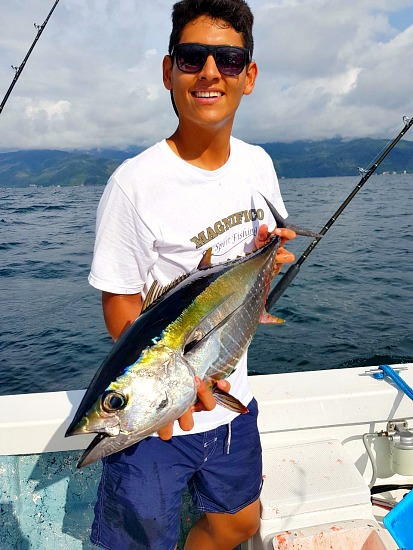 Emanuel Rameriz fishing with his father Capt Cesar of Magnifico with some beautiful Karnada, Bait to us gringos. . .
